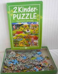 Puzzle-Kinder. Märchenland - 49 Teile, Jahrmarkt - 80 Teile