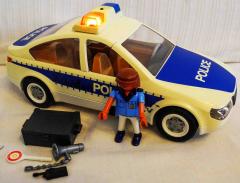 Polizeiauto weiss/blau
